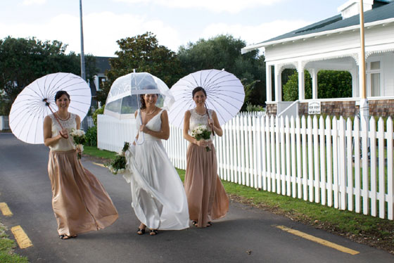 Wedding under parasols at Pompallier